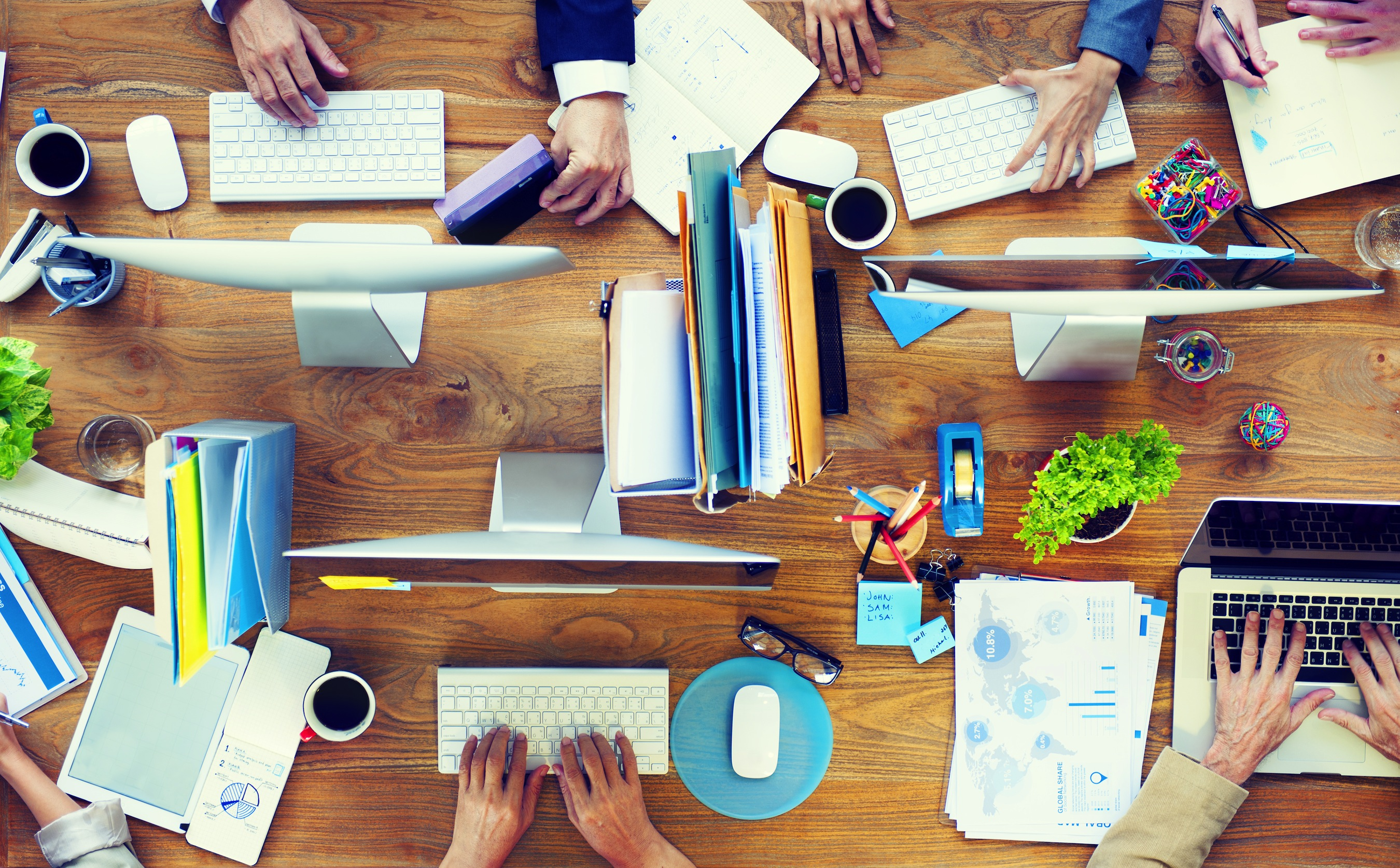 Group of Business People Working on an OfficeDesk